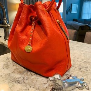 Brahmin tangerine colored bucket bag